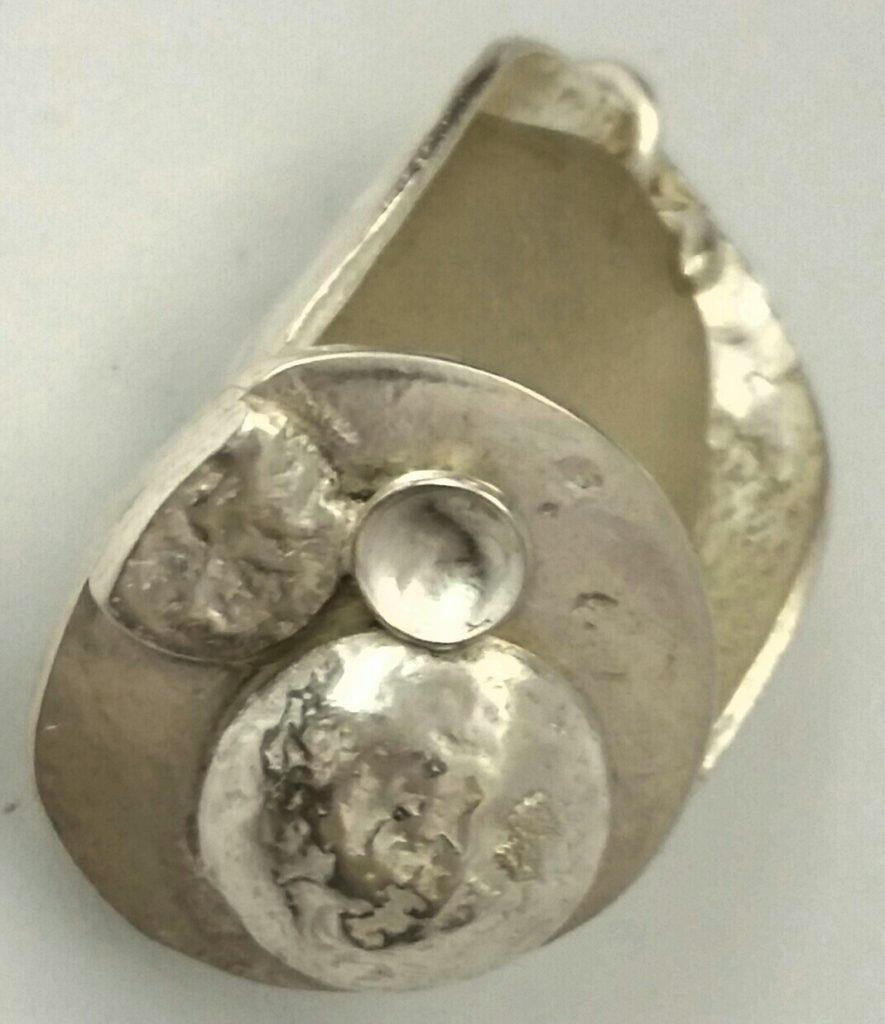 Seashore themed pendant by Syd Meats.